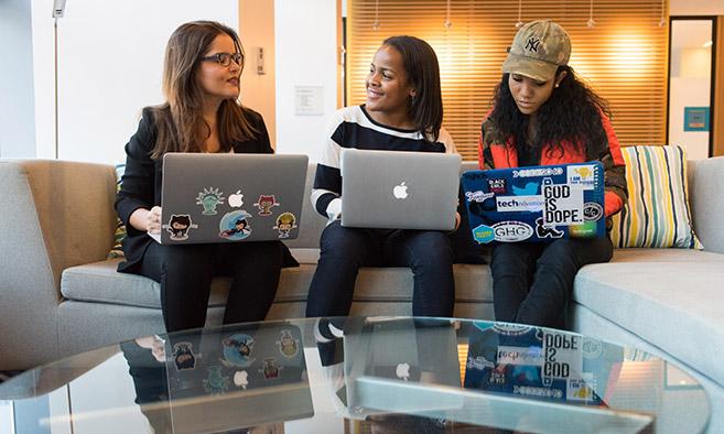 Three girls coding